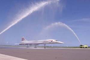 A Concorde jet showered with water on a runway