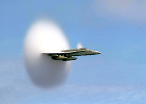 Water vapor cone created just as F/A Hornet breaks the speed of sound