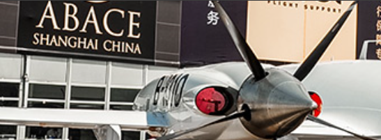 Airplane in foreground of signange for ABACE in Shanghai, China